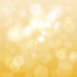 Abstraktes Gold unscharfes bokeh Stockbild