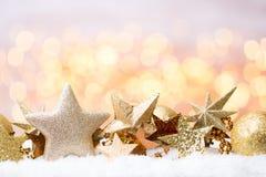 Abstraktes Goldbokeh Weihnachts- und des neuen Jahresthemahintergrund Stockbilder