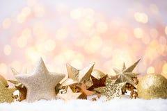 Abstraktes Goldbokeh Weihnachts- und des neuen Jahresthemahintergrund Stockfotos