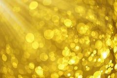 Abstraktes goldenes bokeh defocusted Hintergrundbeschaffenheit Lizenzfreie Stockfotografie