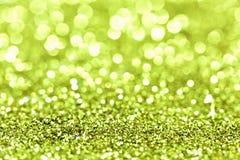 Abstraktes goldenes grünes Licht Bokeh-Hintergrund-Gold Stockfotografie