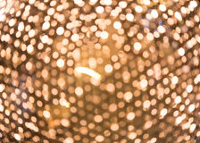 Abstraktes goldenes helles defocused, bokeh Licht Lizenzfreie Stockbilder