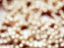 Abstraktes Goldglänzender unscharfer Hintergrund lizenzfreie stockbilder