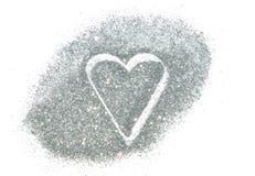 Abstraktes Herz des silbernen Funkelnscheins auf weißem Hintergrund Stockfotos