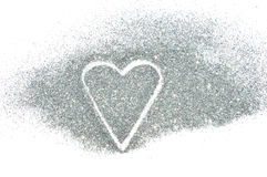 Abstraktes Herz des silbernen Funkelnscheins auf weißem Hintergrund Lizenzfreie Stockbilder