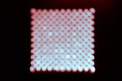 Abstraktes Hintergrund, Blaues und Rotes bokeh auf einem Schwarzen in Form von Quadrat lizenzfreies stockbild