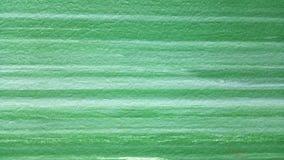 Abstraktes Hintergrundbeschaffenheitsgrün und helle weiße horizontale Streifen t stockfotos