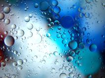 Abstraktes Makro des Wassers und des Öls oben geschlossen Stockfotografie