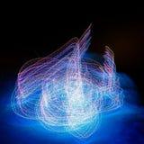 Abstraktes mehrfarbiges Blinklicht im Nebel Lizenzfreies Stockfoto