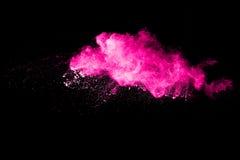 Abstraktes mehrfarbiges Pulver splatted auf schwarzem Hintergrund Stockfoto