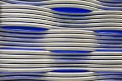 Abstraktes Metall leitet blauen Hintergrund Stockfotografie