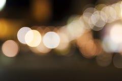 Abstraktes Nacht-Weihnachten-bokeh beleuchtet Hintergrund Stockfoto
