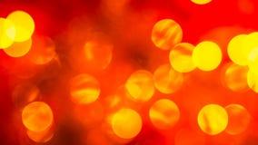 Abstraktes Rot verwischte Hintergrund mit goldenen hellen Kreisen Lizenzfreies Stockfoto
