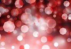 Abstraktes rotes bokeh heller Hintergrund mit Weihnachtsliebe lizenzfreie stockbilder