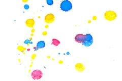 Abstraktes rotes gelbes Spritzen der blauen Tinte Lizenzfreies Stockbild