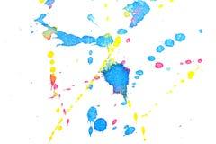 Abstraktes rotes gelbes Spritzen der blauen Tinte Lizenzfreie Stockfotos
