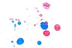 Abstraktes rotes Spritzen der blauen Tinte Stockbild