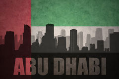 Abstraktes Schattenbild der Stadt mit Text Abu Dhabi an der Flagge der Weinlesevereinigten arabischer emirate Stockbild