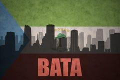 Abstraktes Schattenbild der Stadt mit Text Bata an der Weinleseäquatorialguineaflagge Stockfoto
