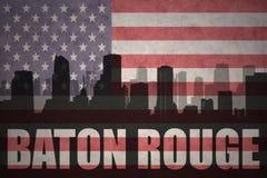 Abstraktes Schattenbild der Stadt mit Text Baton Rouge an der Weinleseamerikanischen flagge Lizenzfreies Stockbild
