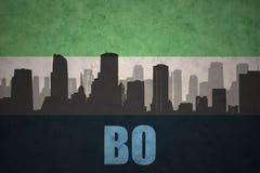 Abstraktes Schattenbild der Stadt mit Text BO an der Weinlesesierra- leoneflagge Lizenzfreie Stockbilder