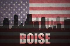 Abstraktes Schattenbild der Stadt mit Text Boise an der Weinleseamerikanischen flagge Stockbild