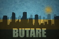 Abstraktes Schattenbild der Stadt mit Text Butare an der ruandischen Flagge der Weinlese Lizenzfreies Stockfoto