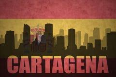 Abstraktes Schattenbild der Stadt mit Text Cartagena an der Weinlesespanischflagge Lizenzfreie Stockfotografie