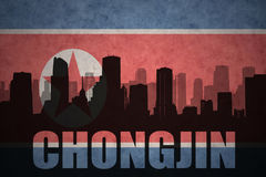Abstraktes Schattenbild der Stadt mit Text Chongjin an der Nordkorea-Flagge der Weinlese Lizenzfreie Stockfotografie