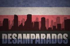 Abstraktes Schattenbild der Stadt mit Text Desamparados an der rican Flagge der Weinlesecosta Stockfotografie