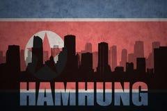 Abstraktes Schattenbild der Stadt mit Text Hamhung an der Nordkorea-Flagge der Weinlese Lizenzfreie Stockbilder