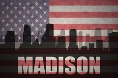 Abstraktes Schattenbild der Stadt mit Text Madison an der Weinleseamerikanischen flagge Lizenzfreie Stockbilder
