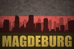 Abstraktes Schattenbild der Stadt mit Text Magdeburg an der Weinlesedeutschflagge Lizenzfreie Stockfotos