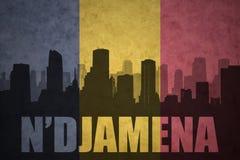 Abstraktes Schattenbild der Stadt mit Text N ` Djamena an der Weinlesekonfettiflagge Stockfotos