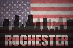 Abstraktes Schattenbild der Stadt mit Text Rochester an der Weinleseamerikanischen flagge Lizenzfreies Stockbild
