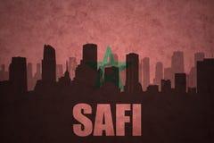 Abstraktes Schattenbild der Stadt mit Text Safi an der Weinlesemarokkanerflagge Stockbilder