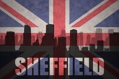 Abstraktes Schattenbild der Stadt mit Text Sheffield an der Weinlesebriten-Flagge Lizenzfreie Stockfotos