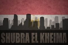 Abstraktes Schattenbild der Stadt mit Text Shubra EL Kheima an der Weinleseägypterflagge Lizenzfreie Stockfotos