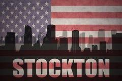 Abstraktes Schattenbild der Stadt mit Text Stockton an der Weinleseamerikanischen flagge Lizenzfreies Stockfoto
