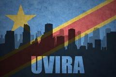 Abstraktes Schattenbild der Stadt mit Text Uvira an der Flagge des Weinlesedemokratischen republiken kongo Stockbilder