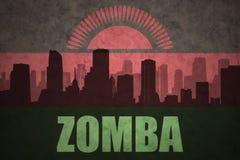 Abstraktes Schattenbild der Stadt mit Text Zomba an der Weinlesemalawi-Flagge Stockfotos