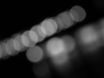 Abstraktes Schwarzweiss--bokeh und undeutlicher Hintergrund Lizenzfreie Stockfotos