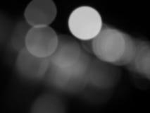 Abstraktes Schwarzweiss--bokeh und undeutlicher Hintergrund Stockbilder
