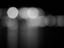 Abstraktes Schwarzweiss--bokeh und undeutlicher Hintergrund Stockfoto