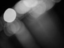 Abstraktes Schwarzweiss--bokeh und undeutlicher Hintergrund Lizenzfreie Stockbilder