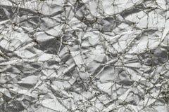 Abstraktes Silber geknitterter Papierbeschaffenheitshintergrund Stockfoto