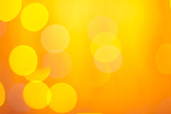 Abstraktes sonniges bokeh auf Orange Lizenzfreie Stockfotografie