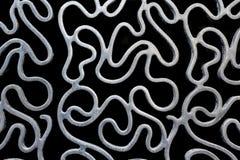 Abstraktes Squiggly Metallmuster Lizenzfreie Stockbilder