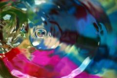 Abstraktes Tröpfchen, bunter Farbhintergrund Lizenzfreie Stockfotografie