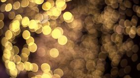 Abstraktes unscharfes Goldfunkeln mit bokeh Effekt auf dunklen Hintergrund stock video